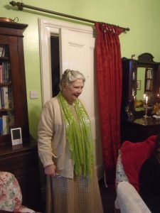 Gill entering the drawing room